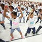 """School children in Durham, N.C., take part in the """"Let's Move! Flash Workout"""" in support of first lady Michelle Obama's initiative to fight childhood obesity."""