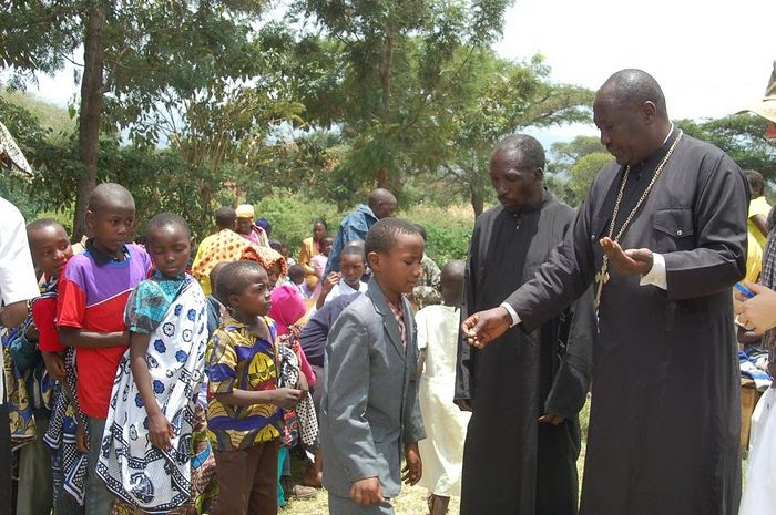Fr. Mark Mwangi with children of the orphanage that he runs with his Presvytera