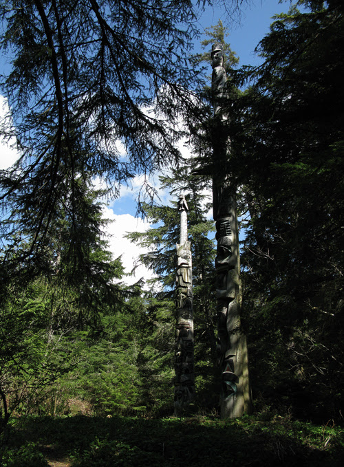 two totems in Kasaan Totem Park, Kasaan, Alaska