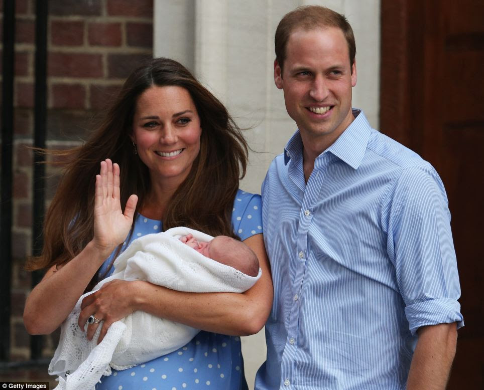 Protective: The baby was wrapped in a white shawl - Kate held her new son closely to her chest as she waved to the impressive crowd