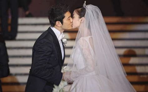 Actors Huang Xiaoming and Angelababy hold fairy tale like