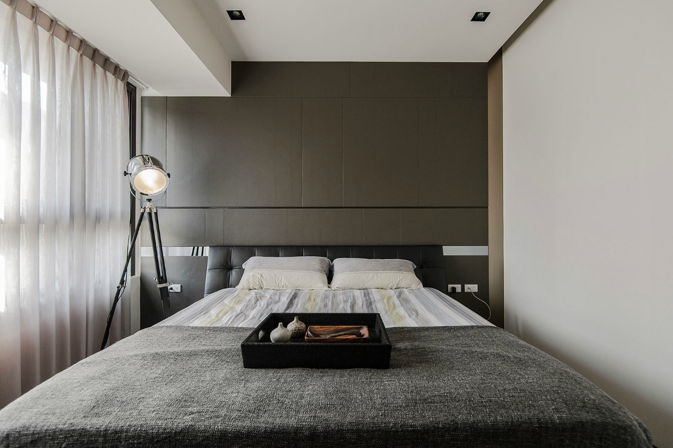 Stone and Wood Make a Dark, Masculine Interior