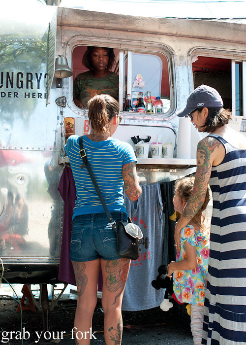 buying donuts at gourdough's big fat donuts food truck austin texas