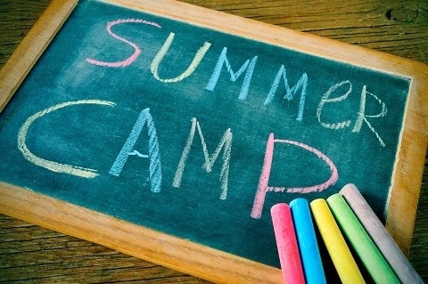 Chalk board with Summer Camp written on it