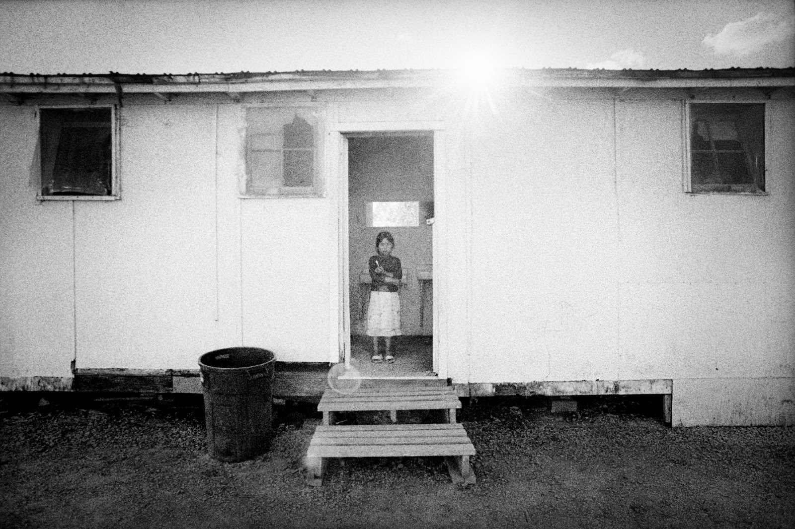 An immigrant girl stands in the bathroom of a migrant camp. Hillsboro, Oregon.