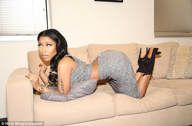 Look at me: Nicki Minaj took to Instagram on Tuesday showing off her pert posterior in a series of shots