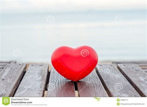 Red Hearts On The Wood Table In The Beach Stock Photo