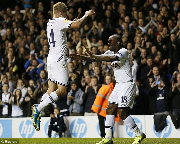 Jump to it: Defoe celebrates scoring his second goal with Lewis Holtby