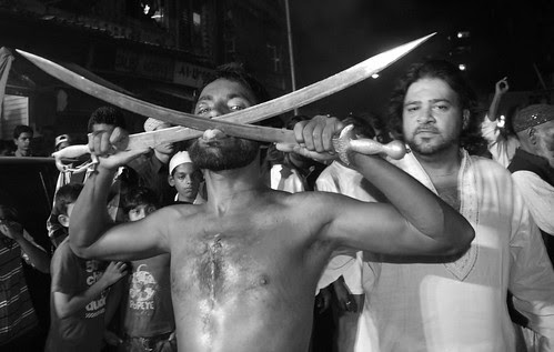 Tongue Cutting With Two Swords .. The Rafaees by firoze shakir photographerno1