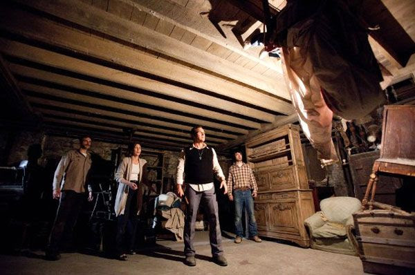 Ed Warren (Patrick Wilson), his wife Lorraine (Vera Farmiga) and their team attempt to exorcise Bathsheba's demonic spirit from her latest victim in THE CONJURING.