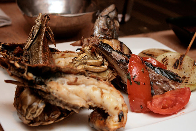 Grilled slipper lobster so tender! Mackerel and onions make up the rest of the seafood grill platter