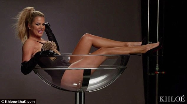 She's keen: Khloe got stuck into the cocktails literally at a promo shoot for her new TV show