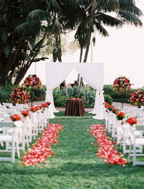 Bright red blooms and crisp white chairs popped against a