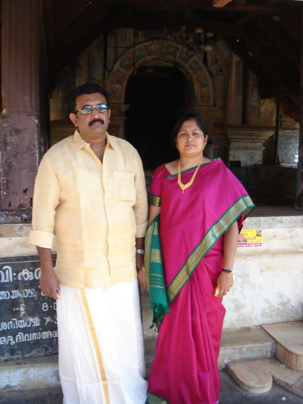 Rajesh and Viji in front of Kadamattom church