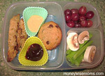 """Thanks to Gina of MoneyWiseMoms for this delicious lunch! Visit her blog to find out where to purchase the colorful silicone baking cups that make this lunch so bright and appealing  http://bit.ly/deS8lD  She writes, """"... leftover chicken tenders from dinner the night before, with honey mustard and BBQ dips, along with his fruits, veggies and dessert. I was skeptical that the dips would stay contained, especially when I saw him swinging his backpack around at his friends at the bus stop, but they did. He was thrilled with lunch and loves having alternatives to sandwiches. I love using leftovers!"""" Thanks Gina!"""