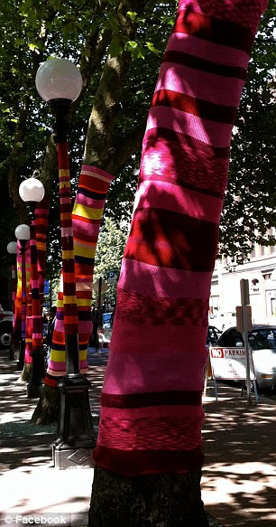 Yarnbombers target lamp posts and trunks on this tree-lined street