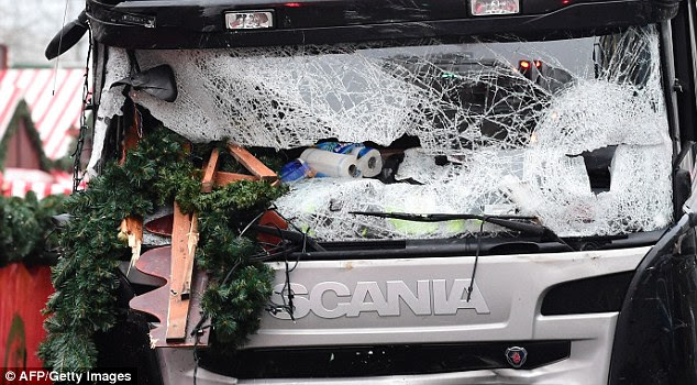 Carnage: Pictures this morning show the broken wind shield of a truck that crashed into the Christmas market