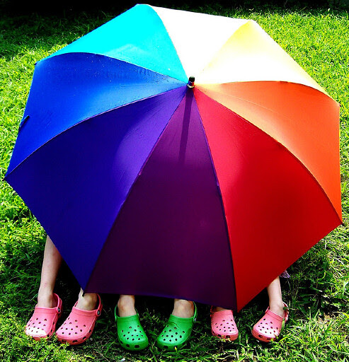 Rainbow umbrella with kids by Pink Sherbet Photography