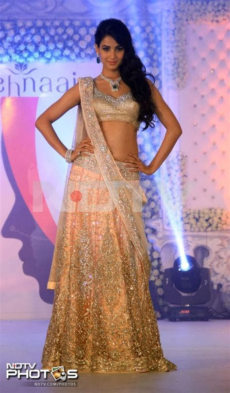 Golden Lehnga with Embroidered for Bridals ? Designers