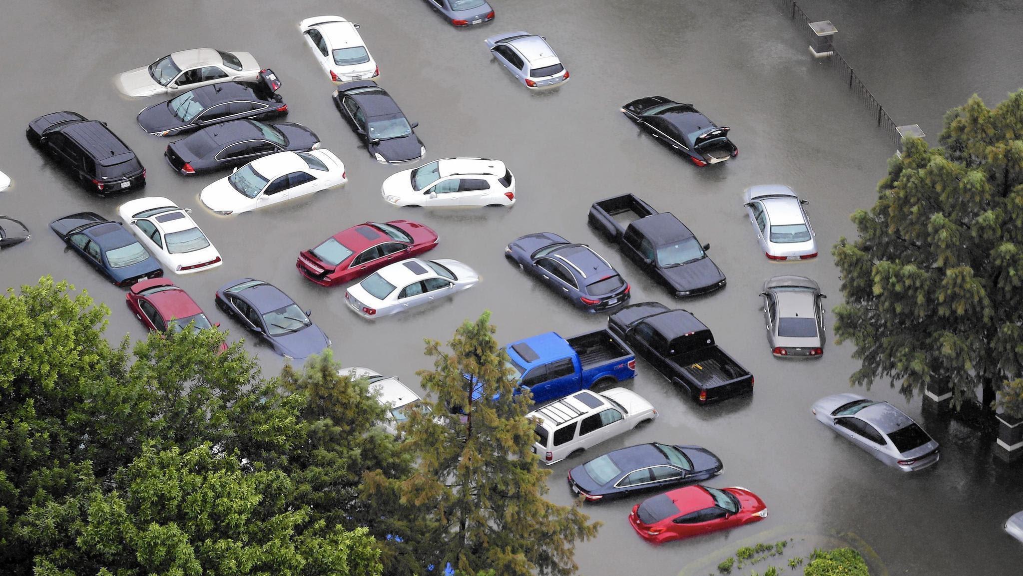 After hurricanes, flood of storm-damaged cars heading for market - Chicago Tribune