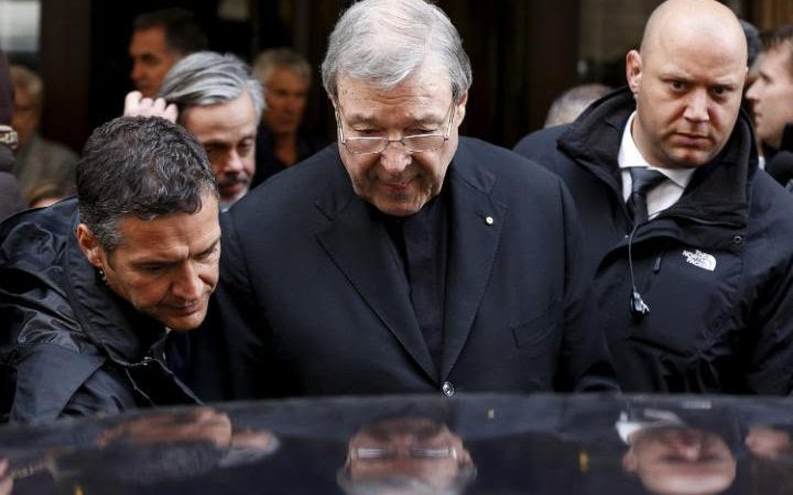 Australian Cardinal George Pell leaves at the end of a meeting with the victims of sex abuse, at the Quirinale hotel in Rome