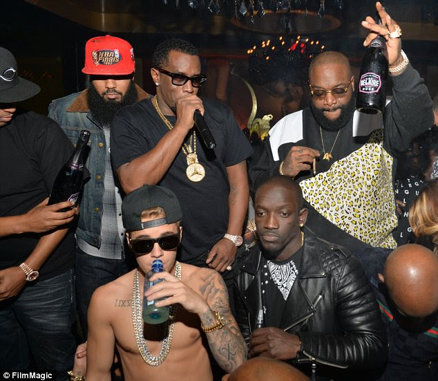 He's a good boy: While his rapper pals were spotted with bottles of alcohol and suspicious looking cigarettes, Bieber appeared to only be drinking flavoured water