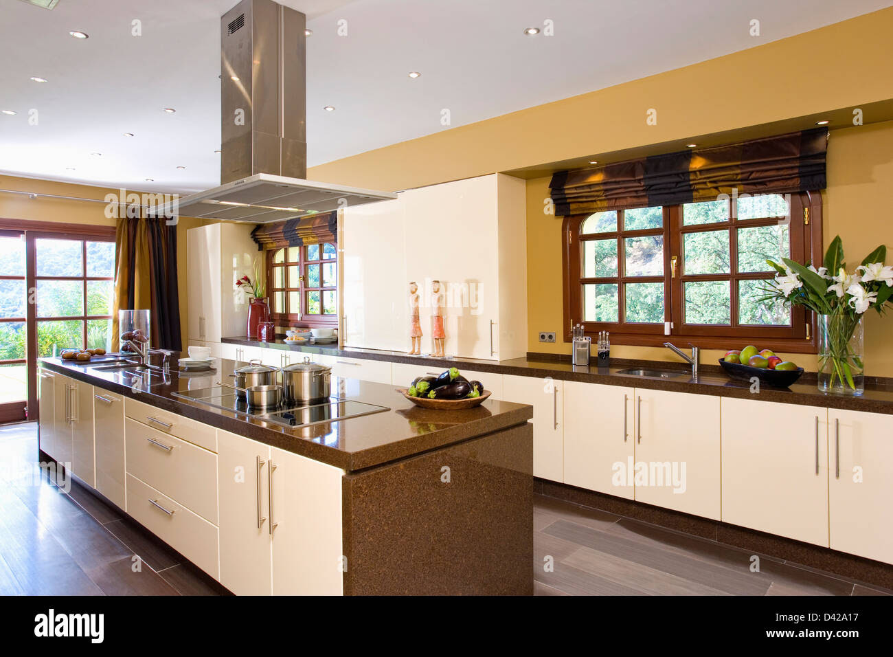 extractor fan over island unit in modern kitchen in spanish villa