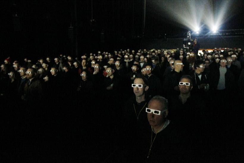 Audience wearing 3D glasses watches a Kraftwerk show