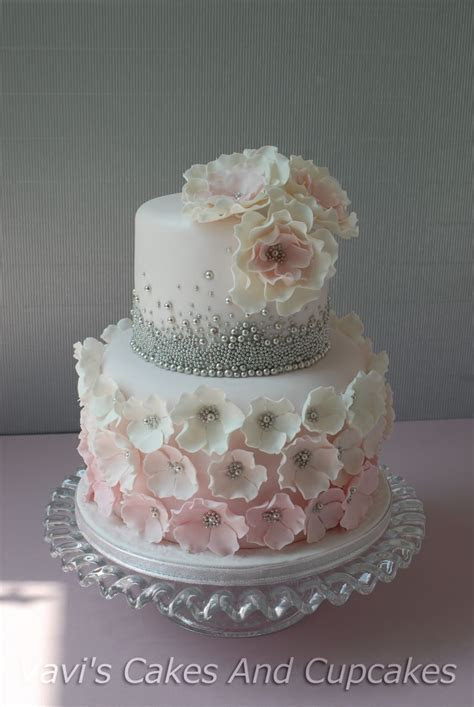 I love the top tier without the flowers. Maybe a 50 on top