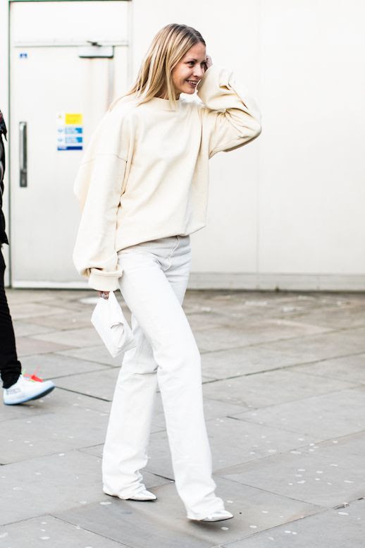 Le Fashion Blog London Fashion Week Cream Oversized Sweater White Flared Jeans Silver Shoes Street Style Via Sandra Semburg