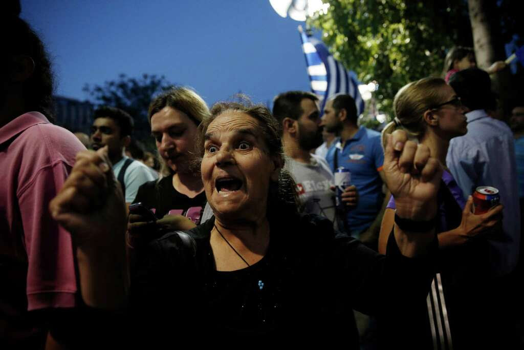 "A supporter of the ""no"" vote expresses her enthusiasm. Meanwhile, Germany's economy minister said Greeks have ""torn down the last bridges"" to compromise. Photo: Petros Giannakouris /Associated Press / AP"