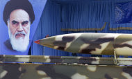 A missile is displayed during a military parade commemorating National Army Day in front of the mausoleum of the late revolutionary founder Ayatollah Khomeini, shown in the picture, left, outside Tehran, Iran, Tuesday, April 17, 2012. (AP Photo/Vahid Salemi)