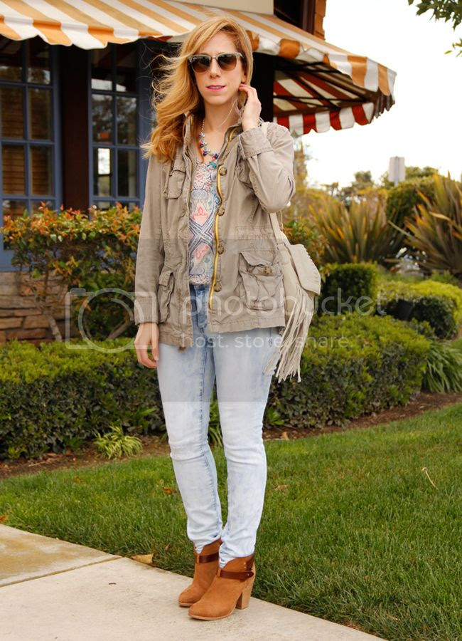 LA fashion blogger The Key To Chic wears a jeweled J Crew necklace, Old Navy field jacket, Mossimo print top, Mossimo light wash skinny jeans, and Rag & Bone Harrow boots