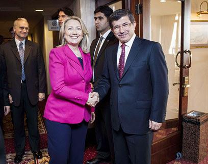 'Broken promises.' Clinton with Turkish FM Davutoglu (Photo: AFP)