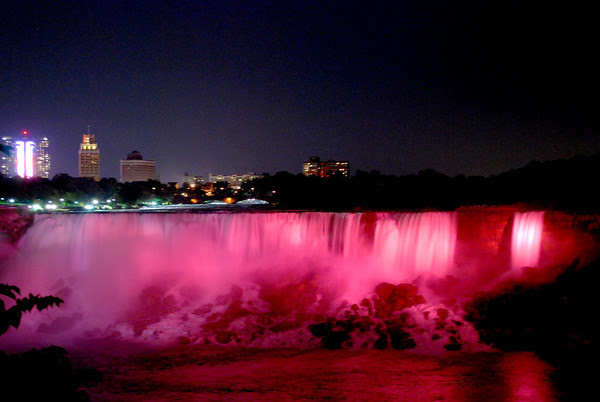 The American Falls take on a red glow during the nightly illumination.