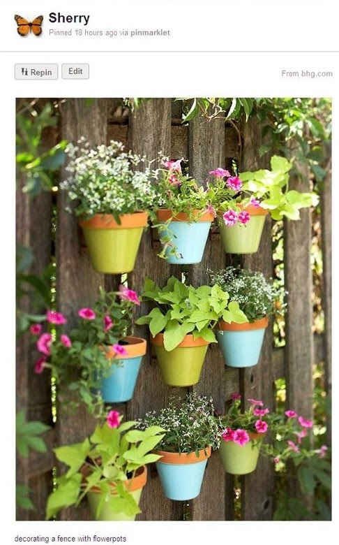Hanging Flower Pots On Fence