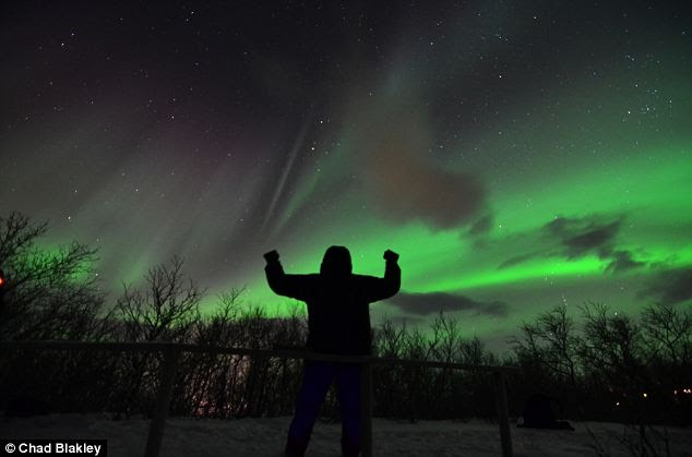The view from Lapland: A human figure stands out against the green sky