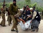 Indian police and civilians carry an injured man after an at