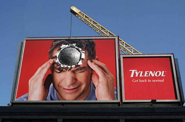 tylenol billboard with headache using big boulder