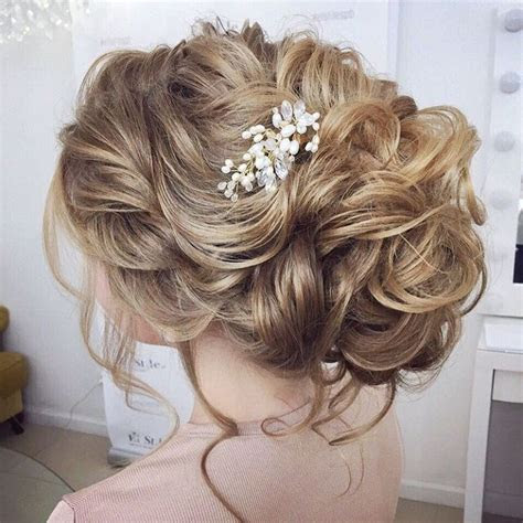 Beautiful loose messy updo hairstyle for romantic brides