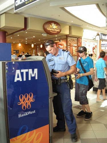cop withdrawing cash