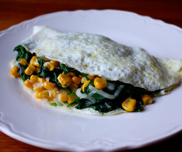 Egg white omelet with Spinach corn and gouda cheese breakfast recipe.