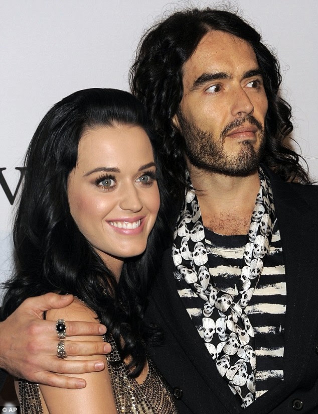 Letting love take the lead: Perry told Elle that she still believes in love despite her divorce from Russell Brand