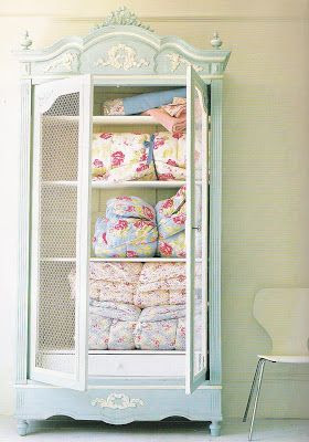 Pretty armoire. This would be amazing to have in the family room to have all the big comfy blankets handy.