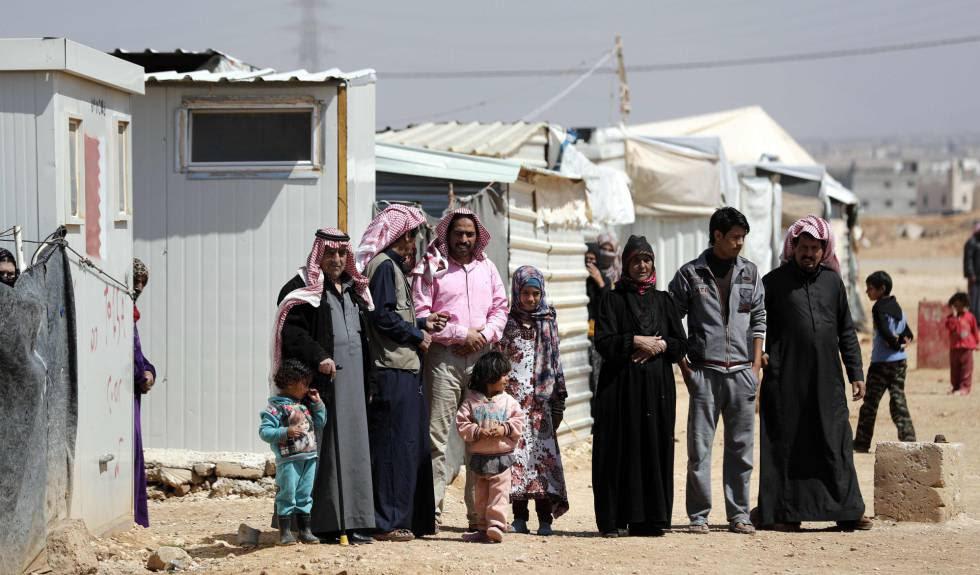 Refugiados sirios, este martes en el campo de Zaatari (Jordania).