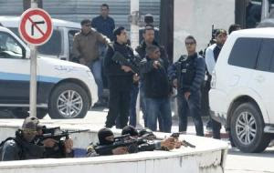 Police officers are seen outside parliament in Tunis