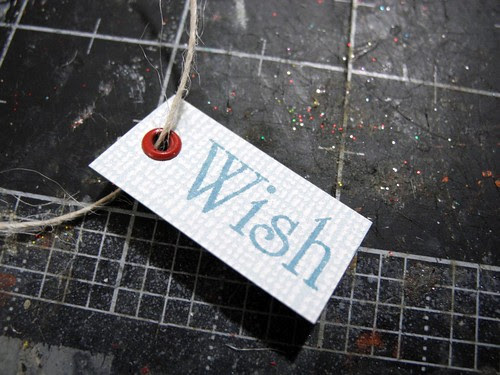 Add eyelet to small tags, stamp and tie with burlap string