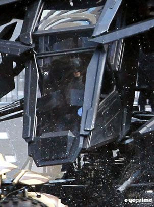 A close-up of Batman inside the Batwing movie prop during filming of THE DARK KNIGHT RISES.