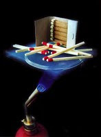 Matches on NASA aerogel, with a flame underneath. A demonstration of aerogel's insulation properties.