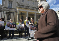 Judy Gross, wife of Alan Gross, an American imprisoned in Cuba, right, takes part in a rally to support her husband, Monday, Nov. 28, 2011, outside the Cuban Interests Section in Washington. (AP Photo/Manuel Balce Ceneta)